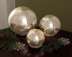 Twinkling Spheres - Make these out of cheap, smoke glass globes, and spray with Krylon looking glass mirror like paint.