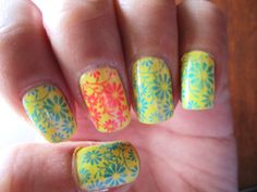 http://www.mymoodymama.blogspot.com  my neon nails using konad nail art
