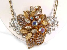 Assemblage Bib Necklace Vintage Rhinestones Faux by VintiqueJools, $85.00. The combo of AB stones and vintage gold is just divine! Beautiful!