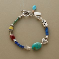 HAPPY DAY BRACELET -- Our exclusive bracelet is sprinkled with a whimsical variety of sterling silver beads