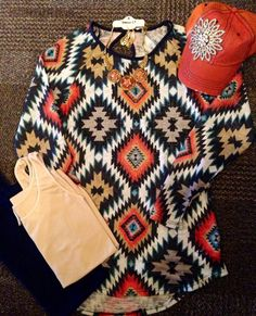 Fall in love with Aztec! #thefunkyzebras #fashion #boutique #shopping #fall #aztec #tribal #rhinestones #orange #womens #clothing