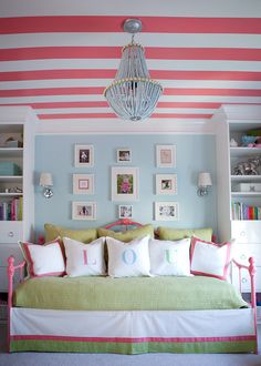 I love the ceiling with the strips an do think these will e the plots of my room, the bed spread I don't care for but the way the bed and the shelfs are put together is clever, I know mom was talking about the shelfing.