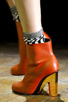Dries van Noten, lucite / Perspex and tangerine orange leather combination, delicious!
