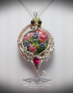 """Wistful Romance -- Once Upon a Time"". Artisan Glass Pendant Necklace Wire Wrapped in .999 Fine Silver & 14K Gold Filled w/ a Faceted Ruby (.80 Ct) & Peridot, Garnet accents. 18"" chain. **Currently Available**"