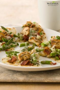 This simple dinner recipe transforms ordinary quesadillas into a delicious and quick appetizer. Cumin complements the flavor of fresh asparagus, mushrooms, Monterey Jack cheese, bacon and green onions in these veggie-loaded quesadillas.