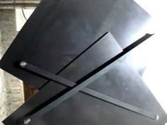 This radical redesign of a door by Austrian artist Klemens Torggler uses a folding and pivoting system to collapse and roll to one side.Instead of a single p...