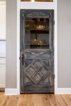 Antique farmhouse door repurposed as a pantry door - by Rafterhouse.