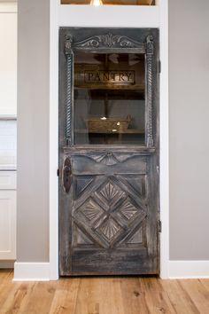 Antique farmhouse door repurposed as a pantry door - by Rafterhouse.