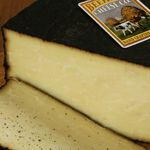 "Barely Buzzed - The cheese is hand rubbed with a Turkish grind of Colorado Legacy Coffee Company's ""Beehive Blend"". The blend consists of a mix of South American, Central American, and Indonesian beans roasted to different styles. French Superior Lavender buds are ground with the coffee and the mixture is diluted with oil to suspend the dry ingredients in the rub."