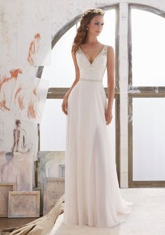 Designer Wedding Dresses and Bridal Gowns by Morilee. This Sheath Bridal Gown has an Embroidered Bodice with Illusion Side Insets and Crystal Beaded Trim.