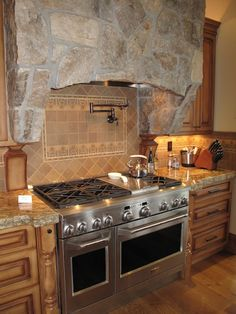 I LOVE THE FAUCETS OVER THE STOVE...ALWAYS NEED WATER WHEN YOUR COOKING