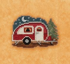 Mill Hill Happy Camper - Beaded Cross Stitch Kit. Kit Includes: Beads, treasures, perforated paper, floss, needles, magnet, chart and instructions. Finished siz