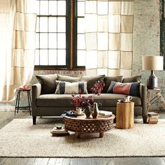 eclectic - modern and rustic  carved wood coffee table - West Elm - $299.99