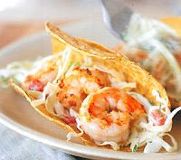 Key West-Style shrimp and fish tacos that will be a perfect compliment to the warm weather.  Let your guests experiment with a smorgasbord of ingredients like: cheeses, tomatoes, lettuce, mango salsa, jalapeno coleslaw and avocados then slather 'em up with a chipotle aioli or cilantro lime dressing. Give it a Southern kick by including beef brisket as an option.