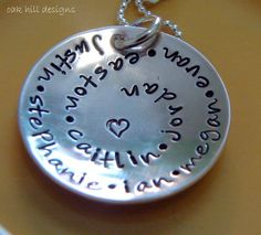 hand stamped personalized sterling silver swirl jewelry-round and round. $33.00, via Etsy.