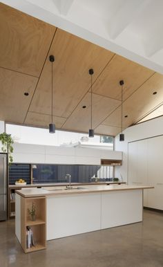 A pendant light arrangement is perfectly in line with the contemporary styling of the kitchen