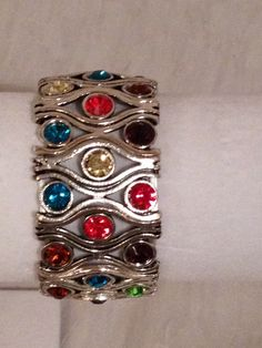 Silver stretch bracelet with multi-color crystals.