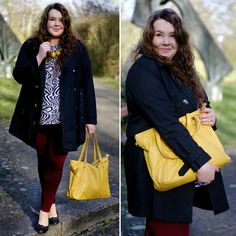 PlusSize Outfit - zebra shirt, burgundy jeggings, yellow necklace, black trench coat and yellow bag.