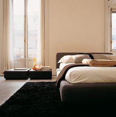 Letto Opium LA FALEGNAMI. Generose testate imbottite lievemente inclinate, in pelle pieno fiore o con rivestimento in splendidi tessuti. Il letto Opium ha un design moderno ed elegante. La sensazione di un confortevole divano interpretato con le sembianze di un comodissimo letto imbottito. Il nome stesso evoca sonni profondi ed appaganti. Bed, Furniture, Home Decor, Elegant, Decoration Home, Stream Bed, Room Decor, Home Furnishings, Beds