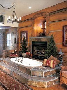 Master bath with custom-built fireplace  -not to mention-the little Christmas trees on either side.  #winter #customdesigned #luxuryliving