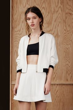 Urban Outfitters // White bomber jacket, a line skirt and sports bra