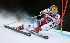 Marcel Hirscher, of Austria, powers past a gate on his way to clock the fastest time during the first run of an alpine ski, men's World Cup giant slalom race, in Alta Badia, Italy, Sunday, Dec. 21, 2014. MARCO TROVATI — AP Photo Read more here: http://www.thestate.com/2014/12/21/3886355/hirscher-leads-1st-run-in-alta.html