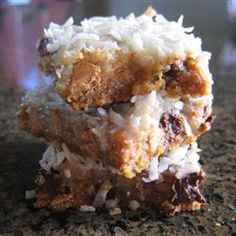 Yummiest cookist!  I call then Seven Layer of Heaven Bars!  I use almond slices instead of walnuts tho. TIP For perfectly cut cookie bars, line entire pan with foil, extending foil over edge of pan. Coat lightly with no-stick cooking spray. After bars have baked and cooled, lift up by edges of foil to remove from pan. Cut into individual bars.