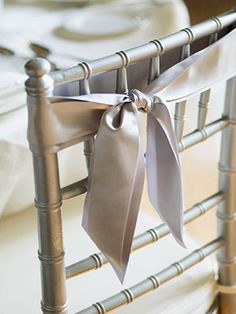Chair ribbons for wedding.no bow just knotted...nice