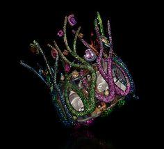 "Wallace Chan ~ ""Fish Whisper"" bangle, featuring yellow diamond, blue topaz, tsavorite garnet, fancy coloured diamond and sapphire. Created in 2015."