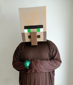 """I know I'm late posting it, but I made this Minecraft Villager costume for my husband this Halloween"""