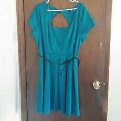 Paperdoll Dark Teal Retro Skater Dress Worn once. There are some stray threads hanging from a few seams, but otherwise in great condition. It is a dark teal color. Very cute retro look topped off with a skinny black belt with a bow. 82% polyester, 13% rayon, 5% spandex. 100% polyester lining. Paperdoll  Dresses