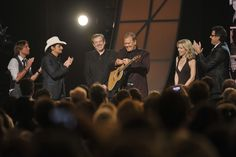 "Keith Urban, Brad Paisley and Vince Gill pay tribute to Glen Campbell at ""The 45th Annual CMA Awards,"" Country Music's Biggest Night, on Wednesday, Nov. 9, 2011 at the Bridgestone Arena in Nashville. [L-R: Keith, Brad, Jimmy Webb, Glen, Glen's wife, Vince]"