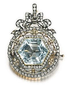 Faberge diamond, aquamarine, and gold brooch.