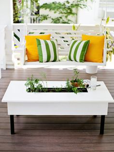 Displaying plants on your coffee table is an obvious idea, but what about planting them inside your coffee table?