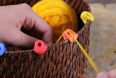Okay, this doesn't apply to every household, but it does to mine -- DIY rubber clips to turn any bowl/basket into a yarn bowl.
