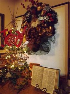 Make a Christmas tree with a tomato cage, grapevine, ivy, and lights.