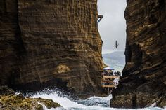 This handout photo received from Red Bull and taken on July 18, 2015 shows Jonathan Paredes of Mexico diving from the 27 metre platform during the fifth stop of the Red Bull Cliff Diving World Series at Islet Franco do Campo, Azores, Portugal. Gary Hunt of the UK won his fifth straight event of the year to take a commanding lead in the series. (Photo by Romina Amato/AFP Photo/Red Bull)