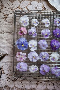 Crystallised edible flowers to decorate your wedding cake http://thenaturalweddingcompany.co.uk/blog/