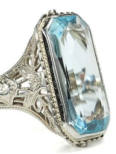 18k white gold filigree mount, this circa 1930 Art Deco ring is set with a faceted aquamarine