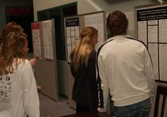 Fall 2012 - Foundations of Communication class posters on display in Shewmaker lobby in December.
