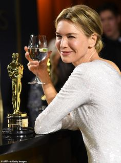 Cheers! The actress enjoyed a refreshing glass of water while attending the Vanity Fair Os...