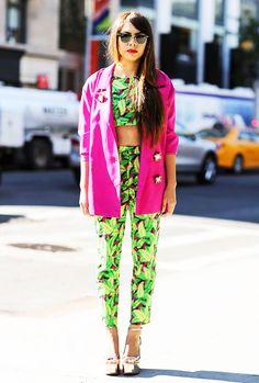 Naye Cerón of El Viento Me Despeina in hot pink blazer and matching printed set