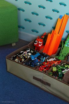 Easily organize your kids' favorite Hot Wheels cars and track in a standard shoe bin for easy storage.