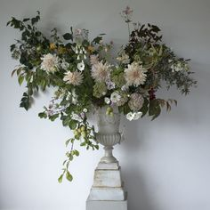 AESME Studio | cast iron urn arrangement with cafe au lait dahlias, nicotiana, maple, japanese anemones and cosmos