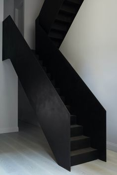Blackened steel stairs by Minale + Mann