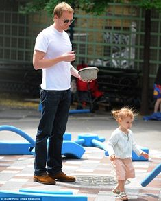 Paul Bettany enjoys a day of fun in the sun at the park with excitable daughter Agnes