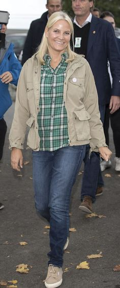 Princess Mette-Marit of Norway looking effortlessly beautiful, wore fitted jeans and a green and white checked shirt. She wore her blonde tresses loose around her shoulders and wore minimal make up. She finished her relaxed outfit off with a pair of almond-coloured trainers.