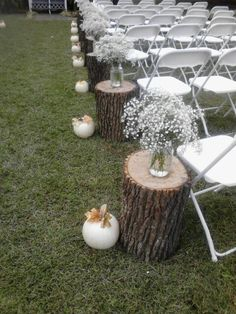 Babies breath  stumps and white pumpkins makes a pretty aisle