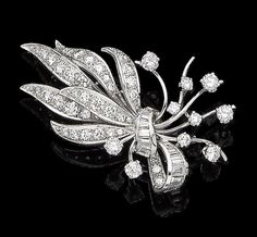 A diamond spray brooch Of floral and ribbon design, set throughout with baguette and brilliant-cut diamonds, diamonds approx. 2.10cts total, length 4.6cm