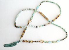 Long Boho Beaded Necklace with Turquoise Verdigris Metal Feather Patina Pendant by BrazedBrand on Etsy https://www.etsy.com/listing/459657700/long-boho-beaded-necklace-with-turquoise
